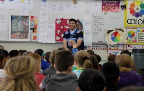 A super day for reading: NPHS football players inspire young students to read