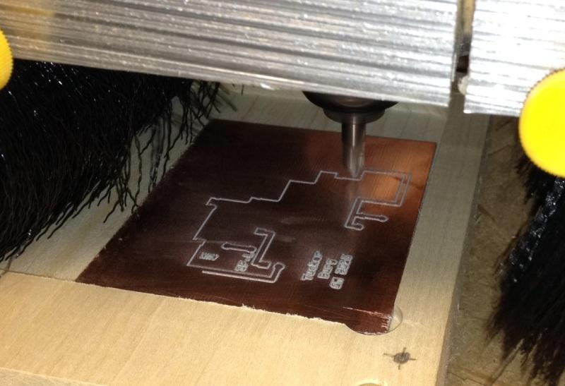 The+pointed+router+bit+spins+at+6000RPM+to+cut+a+0.005%E2%80%9D+deep+groove+in+the+blank+copper+board.++That%E2%80%99s+the+thickness+of+two+sheets+of+paper.+
