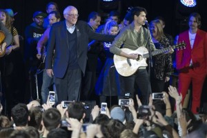 Democratic presidential candidate Sen. Bernie Sanders, I-Vt., left, stands with Vampire Weekend lead singer Ezra Koenig during a campaign rally at the University of Iowa, Saturday, Jan. 30, 2016, in Iowa City, Iowa. (AP Photo/Evan Vucci)