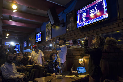 Israelis and Americans watch a live update of the US presidential election results at Mike's place bar in Jerusalem, Wednesday Nov. 9, 2016. (AP Photo/Tsafrir Abayov)