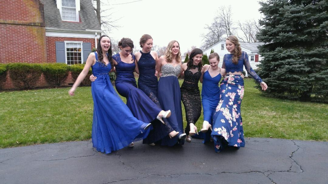 Staff writer Veronica Laguna, third from right, poses with her friends for a photo before junior prom.