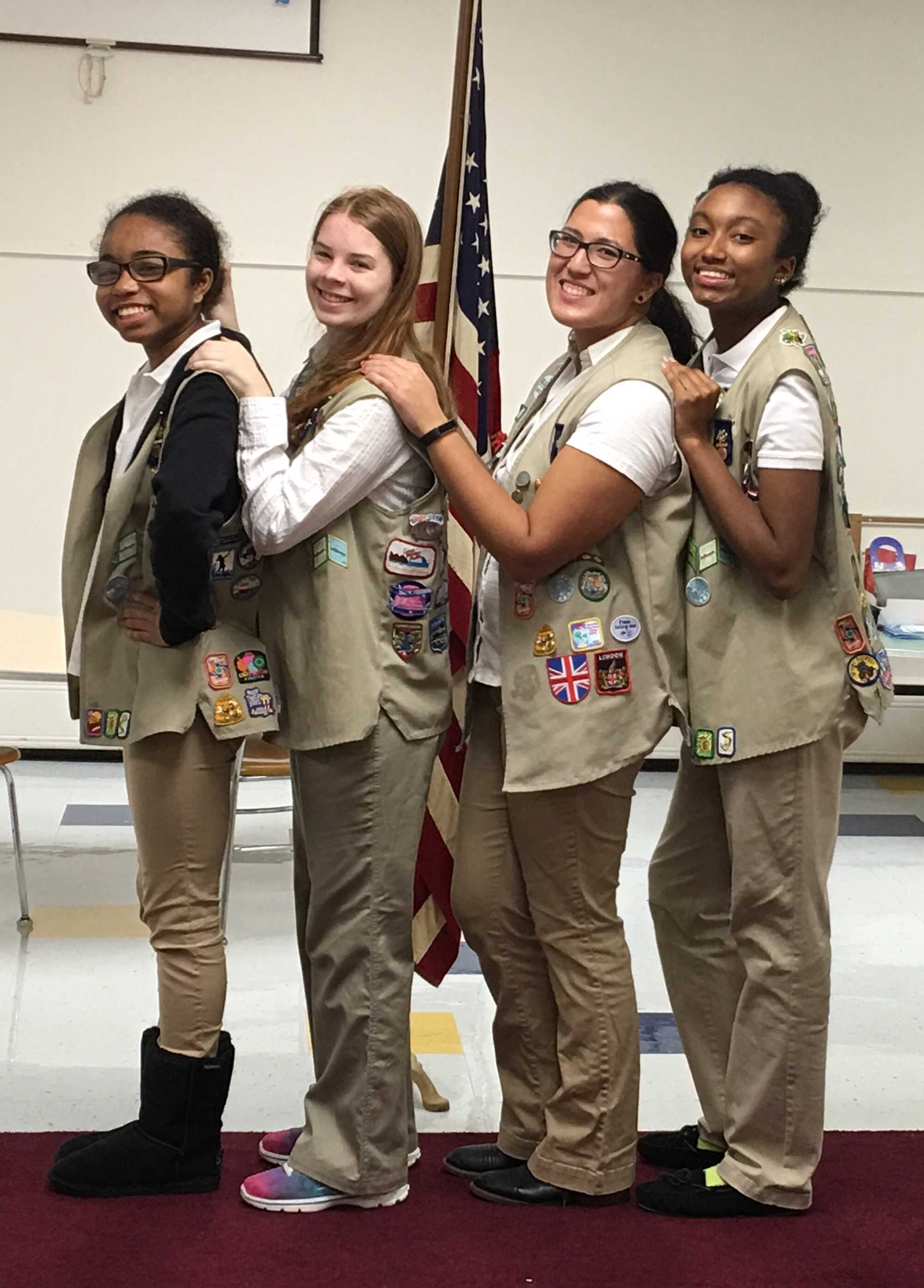 Lauren Wolfe, second from left, stands with three of her friends from Girl Scouts.