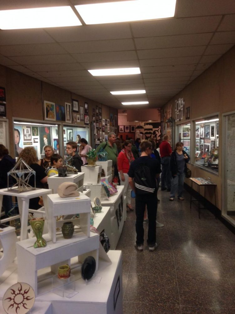 Visitors+admire+the+artwork+of+various+students+at+the+annual+art+show+at+NPHS+last+year.