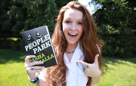 Jess poses with the book