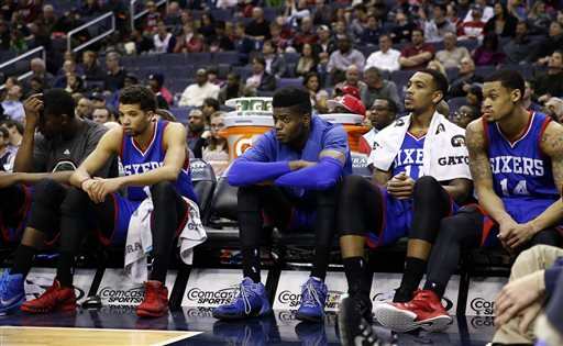 Philadelphia 76ers center Henry Sims, left, guard Michael Carter-Williams, center Nerlens Noel, forward Malcolm Thomas, and guard K.J. McDaniels sit on the bench late in the second half of an NBA basketball game against the Washington Wizards, Monday, Jan. 19, 2015, in Washington. The Wizards won 111-76. (AP Photo/Alex Brandon)