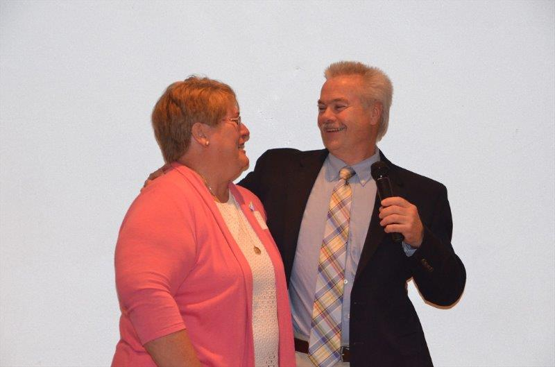 NPHS principal Burt Hynes congratulates Selma Robinson on her retirement last June. Hynes himself will retire in September.