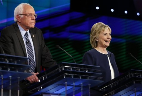 Hillary Rodham Clinton, right, smiles as Sen. Bernie Sanders, of Vermont, speaks during the CNN Democratic presidential debate Tuesday, Oct. 13, 2015, in Las Vegas. (AP Photo/John Locher)