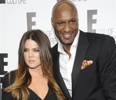"FILE - In this April 30, 2012 file photo, Khloe Kardashian Odom and Lamar Odom from the show ""Keeping Up With The Kardashians"" attend an E! Network upfront event at Gotham Hall in New York. Odom, the former NBA star and reality TV personality embraced by teammates and fans alike for his humble approach to fame, was hospitalized and his estranged wife Khloe Kardashian is by his side, after being found unresponsive in a Nevada brothel where he had been staying for days. (AP Photo/Evan Agostini, File)"