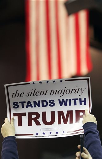 A Trump supporter holds a campaign sign as Republican presidential candidate Donald Trump speaks during a campaign rally at the Pensacola Bay Center in Pensacola, Fla., Wednesday, Jan. 13, 2016. (AP Photo/Michael Snyder)