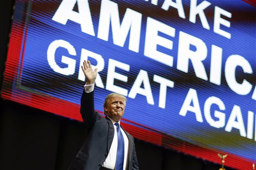 Republican presidential candidate, businessman Donald Trump waves has he arrives for a campaign rally Monday, Feb. 8, 2016, in Manchester, N.H. (AP Photo/David Goldman)