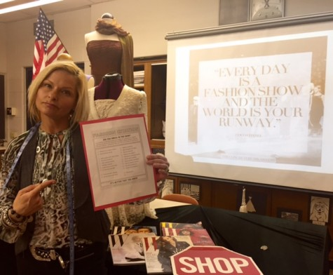 "North Penn Fashion teacher Ms. Joelle Townsend with her ""fashion citation"" for students who choose to break the new, stricter dress code."