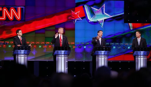 Republican presidential candidate, Sen. Ted Cruz, R-Texas, speaks, as Republican presidential candidates, Sen. Marco Rubio, R-Fla., left, and businessman Donald Trump attempt to interrupt, during the Republican presidential debate sponsored by CNN, Salem Media Group and the Washington Times at the University of Miami,  Thursday, March 10, 2016, in Coral Gables, Fla. Republican presidential candidate, Ohio Gov. John Kasich is at right. (AP Photo/Wilfredo Lee)