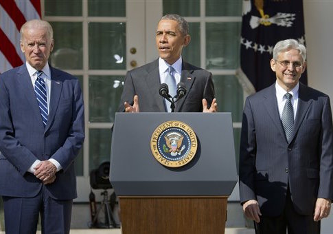 Federal appeals court judge Merrick Garland, right, stands with President Barack Obama and Vice President Joe Biden as he is introduced as Obamas nominee for the Supreme Court. (AP Photo/Pablo Martinez Monsivais)