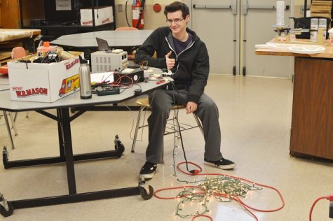 Electronics students navigating through new project