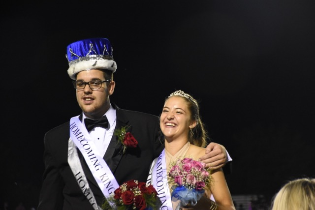 Ben Hartranft and Victoria Braeunle posing together for photos after being crowned the North Penn High School 2016 Homecoming king and queen.