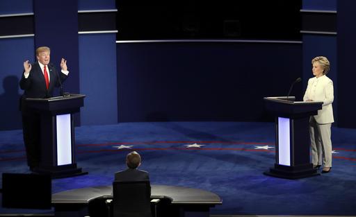 Republican presidential nominee Donald Trump debates Democratic presidential nominee Hillary Clinton during the third presidential debate at UNLV in Las Vegas, Wednesday, Oct. 19, 2016. (AP Photo/Julio Cortez)