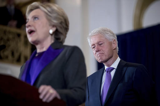 Former President Bill Clinton listens as his wife, Hillary Clinton, speaks to staff and supporters at the New Yorker Hotel in New York, Wednesday, Nov. 9, 2016, where she conceded her defeat to Republican Donald Trump after the hard-fought presidential election.  (AP Photo/Andrew Harnik)
