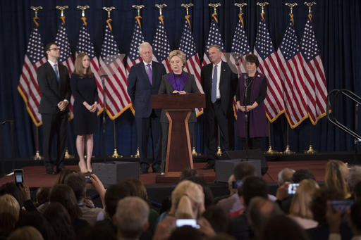 Democratic presidential candidate Hillary Clinton, accompanied by, from left, son-in-law Marc Mezvinsky, daughter Chelsea Clinton, husband, former President Bill Clinton, vice presidential candidate, Sen. Tim Kaine, D-Va., and his wife Anne Holton, speaks in New York, Wednesday, Nov. 9, 2016. Clinton conceded the presidency to Donald Trump in a phone call early Wednesday morning, a stunning end to a campaign that appeared poised right up until Election Day to make her the first woman elected U.S. president. (AP Photo/Matt Rourke)