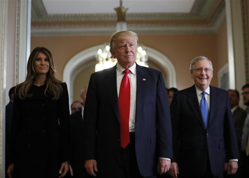 Melania Trump, and her husband President-elect Donald Trump, center, walk with Senate Majority Leader Mitch McConnell, of Kentucky, as they depart after a meeting on Capitol Hill, Thursday, Nov. 10, 2016 in Washington. (AP Photo/Alex Brandon)