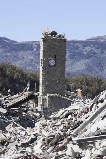 The bell tower of Amatrice, central Italy, which stood standing after the Aug. 24, 2016 earthquake, is seen with its top part collapsed after an earthquake with a preliminary magnitude of 6.6 struck central Italy, Sunday, Oct. 30, 2016. A powerful earthquake rocked the same area of central and southern Italy hit by quake in August and a pair of aftershocks last week, sending already quake-damaged buildings crumbling after a week of temblors that have left thousands homeless. (Massimo Percossi/ANSA via AP)