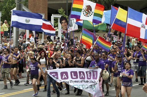 FILE - In this Sunday, June 8, 2014 file photo, people march in the annual Pride Day Parade in Philadelphia. Around the globe, LGBT Pride Month has been marked with parades and marches, festivals and dances, and in some cases, protests and counter-protests. In the United States, much of the celebrations have focused on a string of victories in states where gay marriage bans were overturned. Same-sex marriage is now legal in Pennsylvania. (AP Photo/ Joseph Kaczmarek, File)