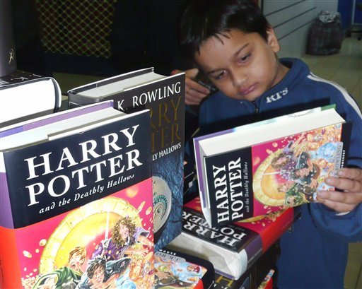 A Kenyan boy selects his book in the Harry Potter series, entitled 'Harry Potter and the Deathly Hallows',   in a book store  as they go on sale in Nairobi, Kenya, Saturday, July 21, 2007.(AP Photo/Sayyid Azim)