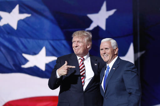 Republican presidential Candidate Donald Trump, points toward Republican Vice presidential candidate Gov. Mike Pence of Indiana after Pences acceptance speech during the third day session of the Republican National Convention in Cleveland, Wednesday, July 20, 2016. (AP Photo/Mary Altaffer)