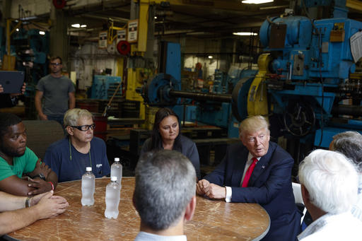 Republican presidential candidate Donald Trump talks with a group of factory workers during a tour of McLanahan Corporation headquarters, a company that manufactures mineral and agricultural equipment, Friday, Aug. 12, 2016, in Hollidaysburg, Pa. (AP Photo/Evan Vucci)