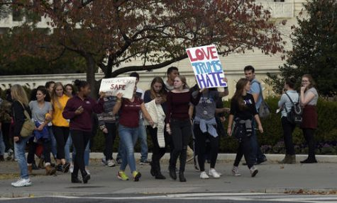 Washington area high school students protest near the Supreme Court in Washington, Tuesday, Nov. 15, 2016. Hundreds of demonstrators are gathered outside the Supreme Court to protest Donald Trump's election. They are mostly young people who appear to have walked out of school to protest. (AP Photo/Susan Walsh)