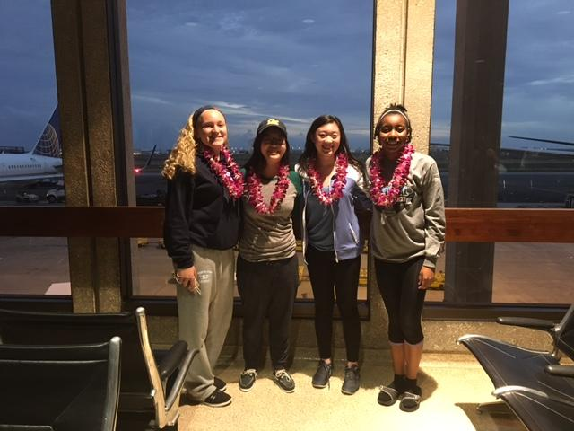 Alison Maxwell, Jessica Liu, Stephanie Zhang, and Daelin Brown posing at the airport