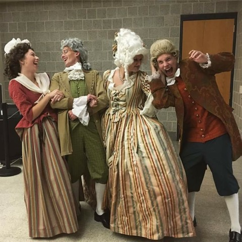 Francis Burk, second from the left, poses for a photo with his fellow actors after the fall play, She Stoops to Conquer.