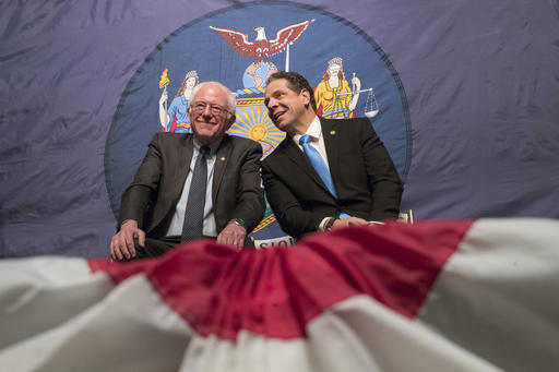 New York Gov. Andrew Cuomo, right, and Vermont Sen. Bernie Sanders appear onstage together during an event at LaGuardia Community College, Tuesday, Jan. 3, 2017, in New York. Gov. Cuomo announced a proposal for free tuition at state colleges to hundreds of thousands of low- and middle income residents. Under the governor's plan, which requires legislative approval, any college student accepted to a New York public university or two-year community college is eligible, provided their family earns less than $125,000. (AP Photo/Mary Altaffer)