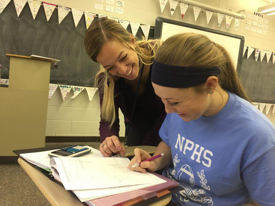 Miss Truskowski helps North Penn HIgh School sophomore Rebecca Brandolph in an Algebra II class at North Penn High School. Truskowski joined the North Penn High School staff this year.