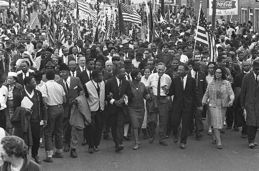 Dr. Martin Luther King, third from right, marchers across the Alabama River on the first of a five day, 50 mile march to the state capitol at Montgomery, Ala., on March 21, 1965. (AP Photo)