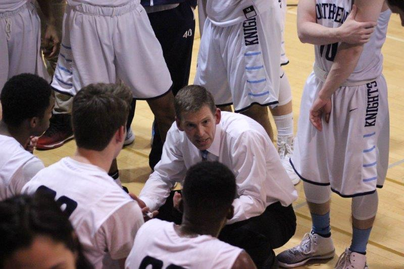 NPHS+basketball+coach+John+Conrad+talks+to+his+team+during+a+recent+conference+game+at+NPHS.