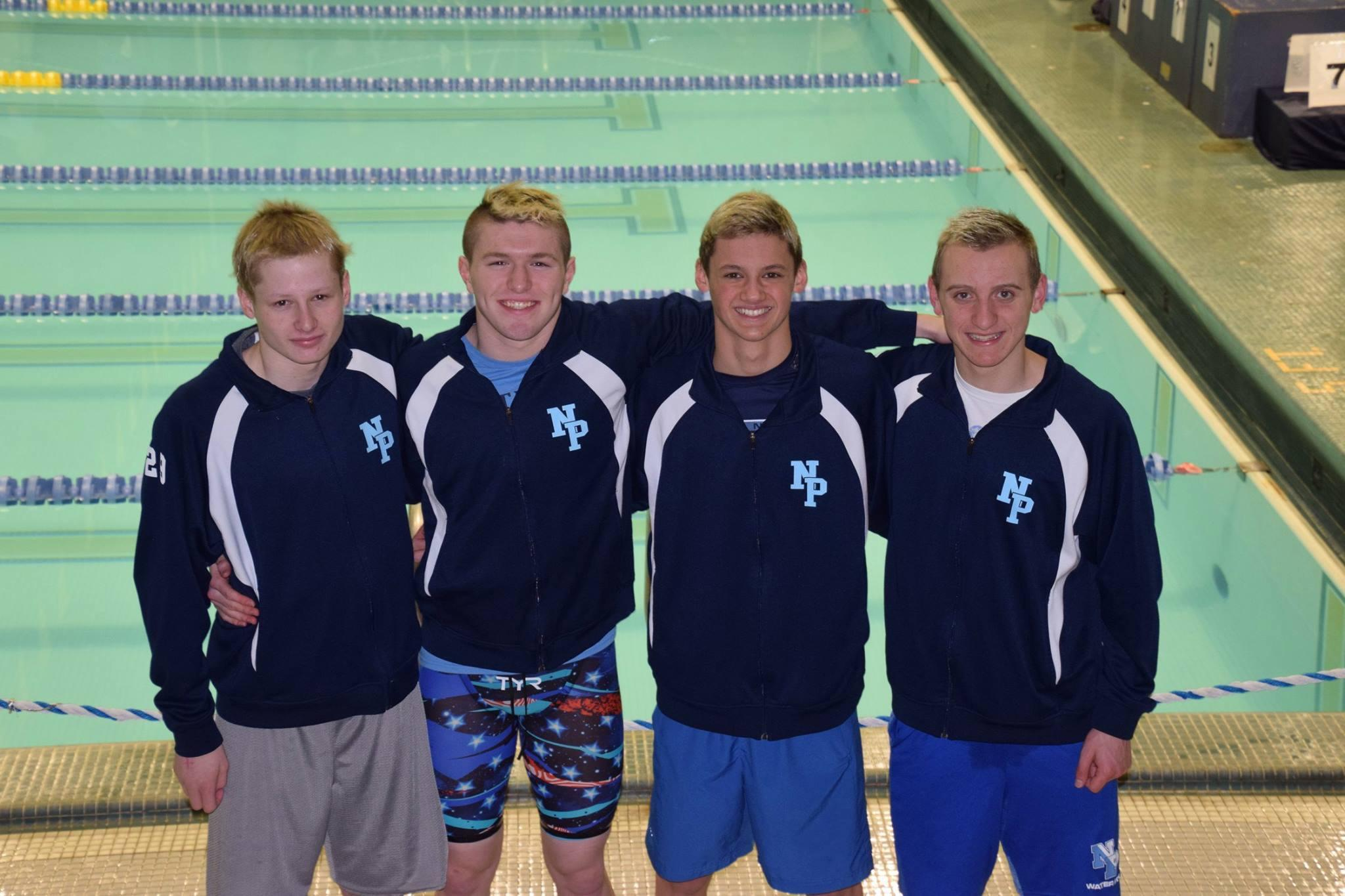 Noah Jamieson, second from the left, poses for a photo with his teammates.