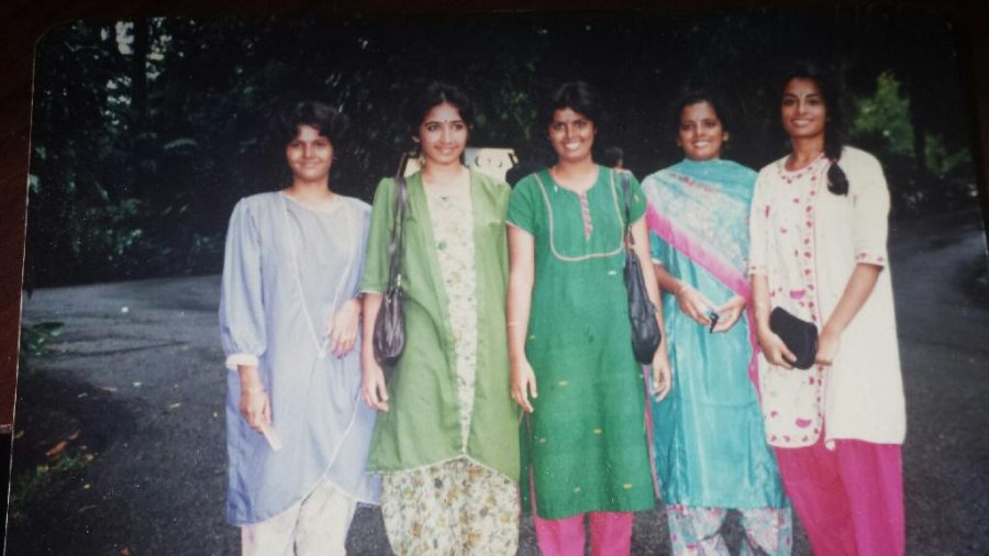 Ramans mother with her two sisters and two friends growing up in India. They are all immigrants and citizens in the blended States of America.