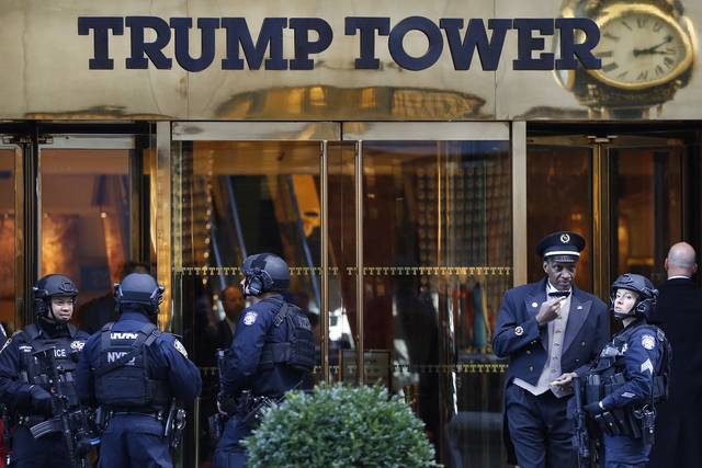 In+this+Nov.+14%2C+2016+file+photo%2C+members+of+the+New+York+Police+Department%27s+counter-terrorism+unit+guard+Trump+Tower+in+New+York.