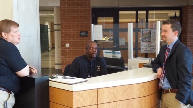 Mr.+Chris+Doerr%2C+the+new+Coordinator+of+Emergency+Management+and+Safe+Schools+for+North+Penn+School+District%2C+chats+with+two+of+NPHS%27s+security+guards.