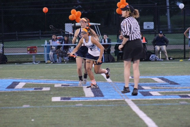 Mikayla+Barrow+battles+for+possession+in+the+Lady+Knights+game+vs+CB+East+on+Wednesday+evening.+The+LAX+for+Leukemia+game+also+helped+to+raise+money+to+fight+Leukemia+and+Lymphoma.+
