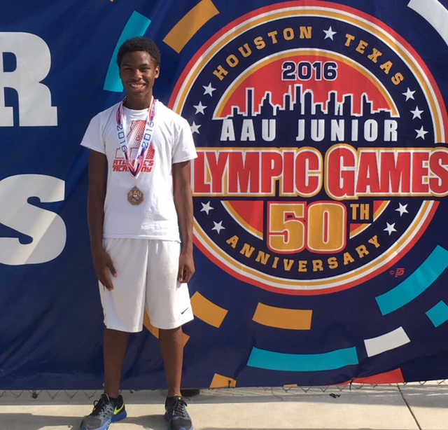 Zahir+Rucker+shows+off+his+hardware+at+the+2016+AAU+Junior+Olympic+Games+in+Houston%2C+Texas.