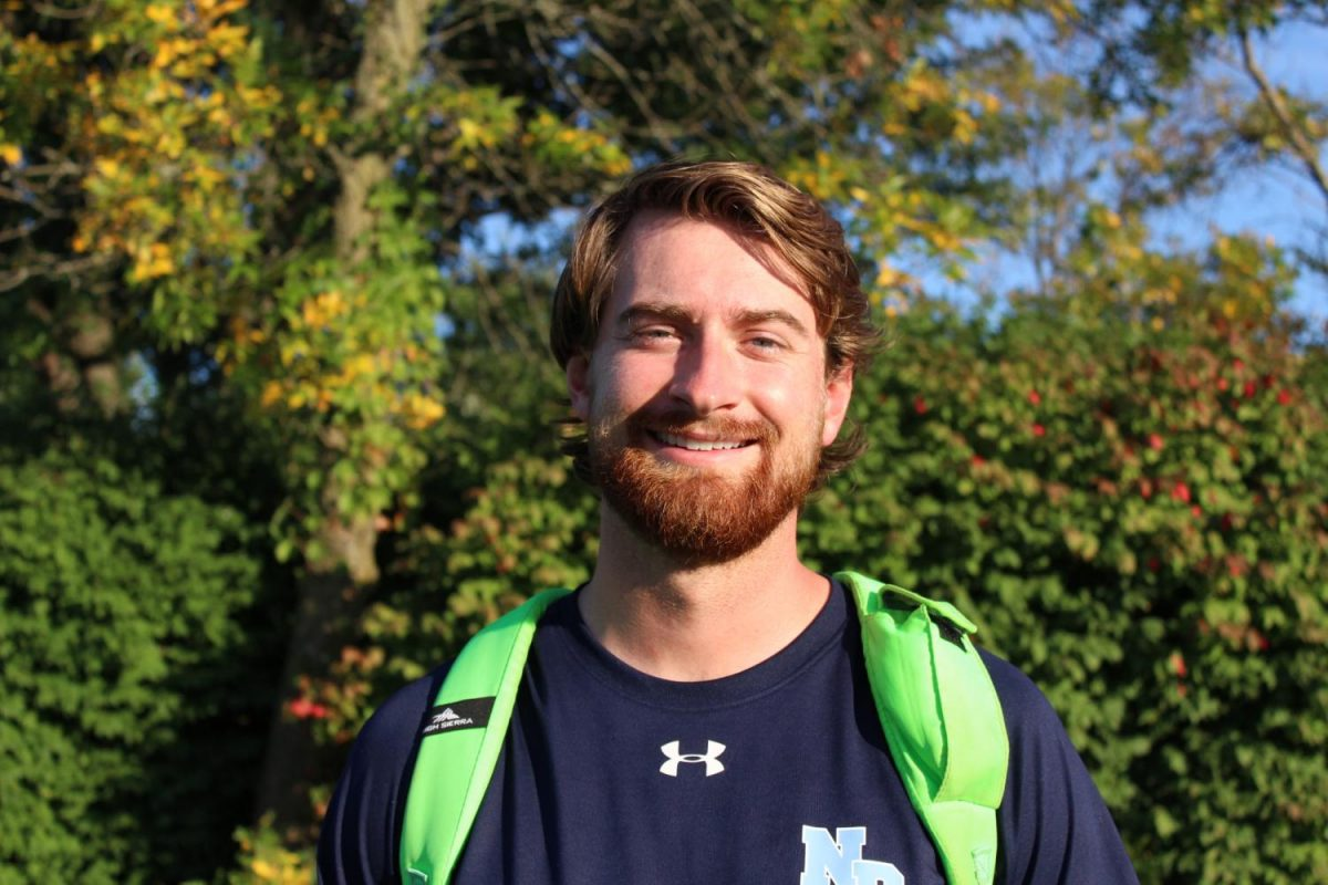 Mr. Schmitz steps onto the playing field of teaching and coaching, expecting fun and victories in both.