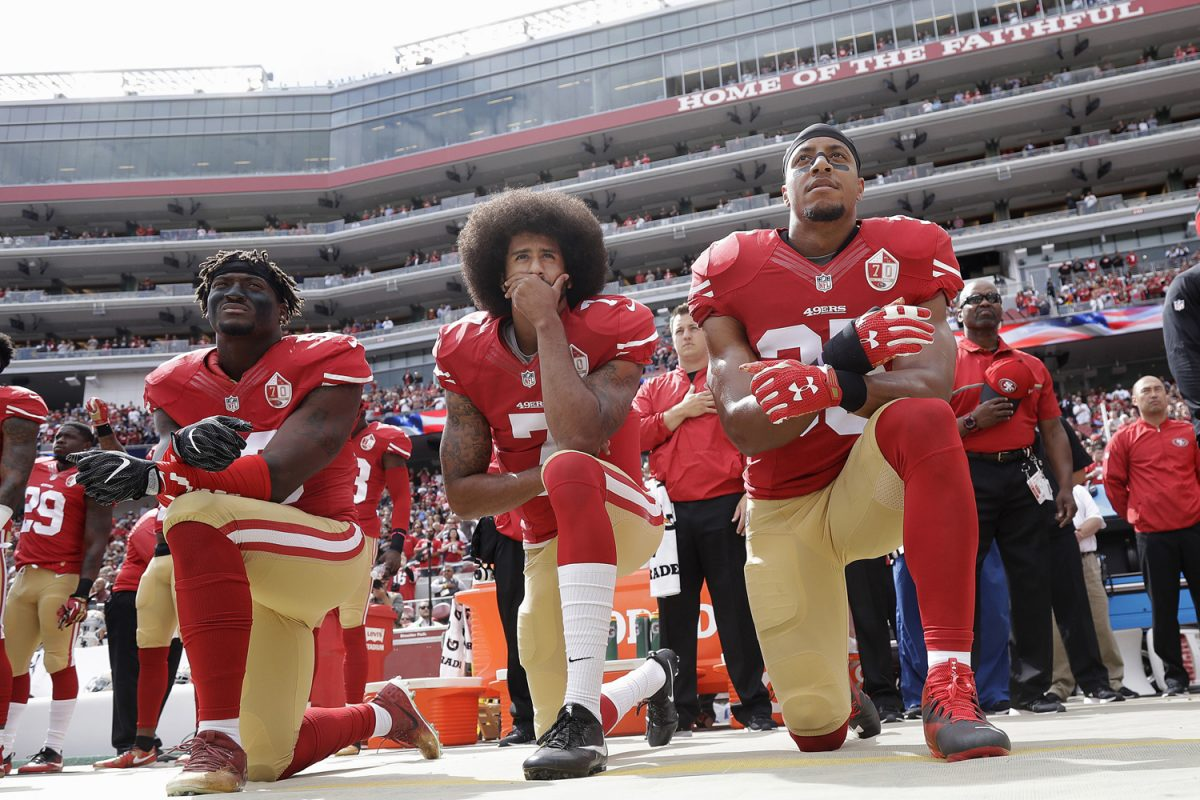 FILE+-+In+this+Oct.+2%2C+2016+file+photo%2C+from+left%2C+San+Francisco+49ers+outside+linebacker+Eli+Harold%2C+quarterback+Colin+Kaepernick+and+safety+Eric+Reid+kneel+in+protest+during+the+national+anthem+before+an+NFL+football+game+against+the+Dallas+Cowboys+in+Santa+Clara%2C+Calif.+%28AP+Photo%2FMarcio+Jose+Sanchez%2C+File%29