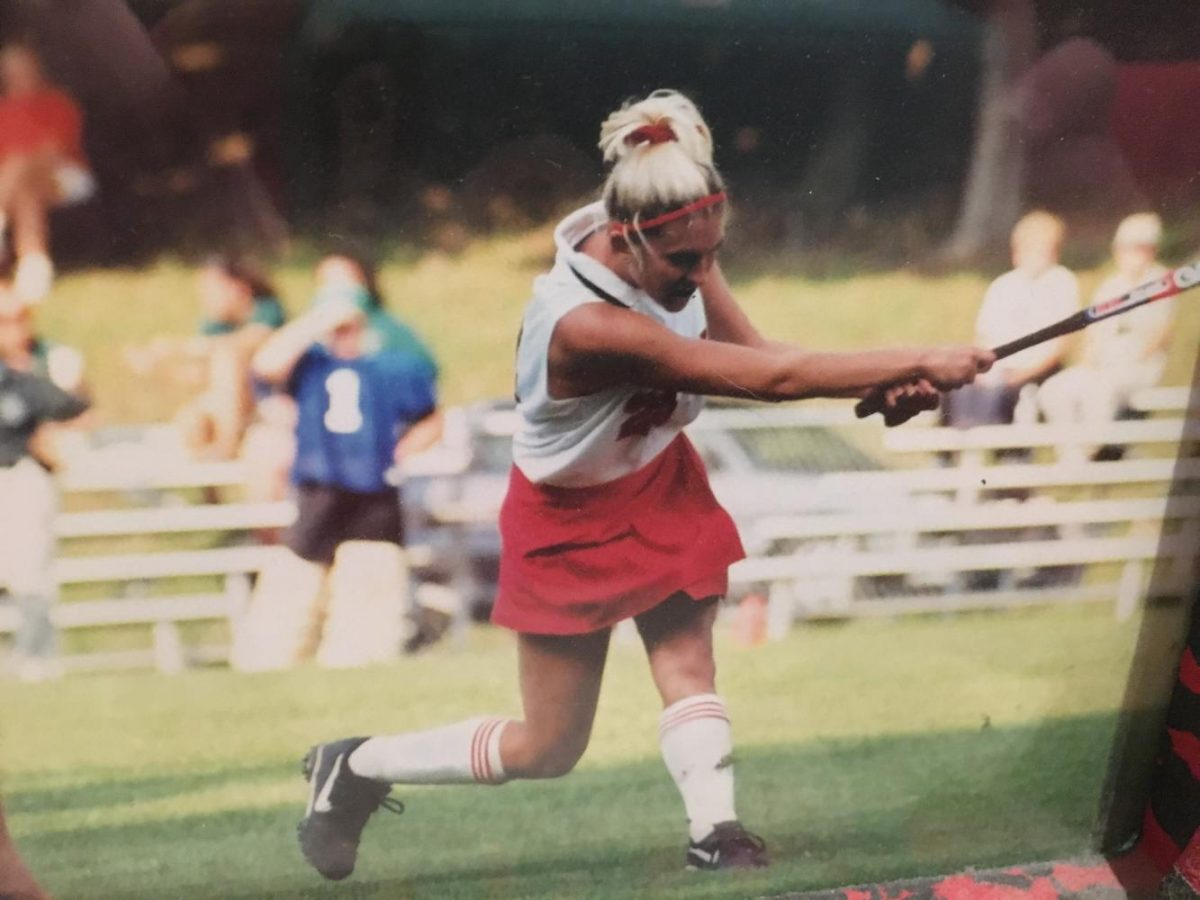 Shannon+McCracken+follows+through+after+hitting+a+ball+while+playing+collegiate+hockey.