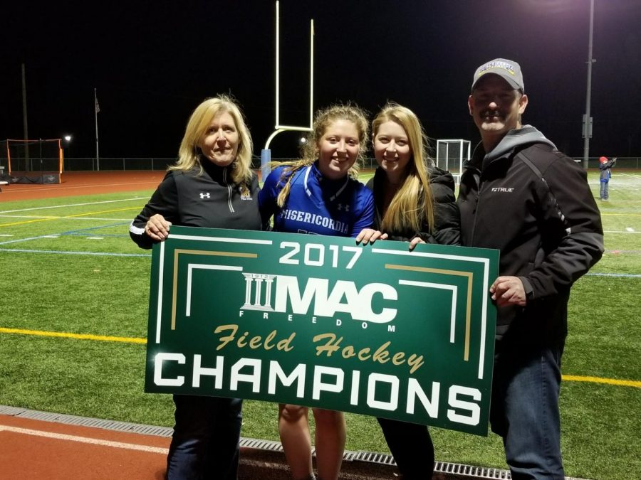 Jenna+Whitman%2C+North+Penn+graduate+class+of+2017%2C+stands+next+to+her+parents+and+sister+after+winning+the+Conference+Championship