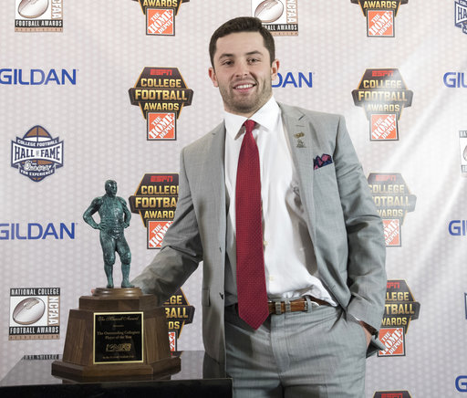 Oklahoma quarterback Baker Mayfield, winner of the Maxwell Award, poses with the trophy during the College Football Awards show at the College Football Hall of Fame, Thursday, Dec. 7, 2017, in Atlanta. (AP Photo/John Amis)