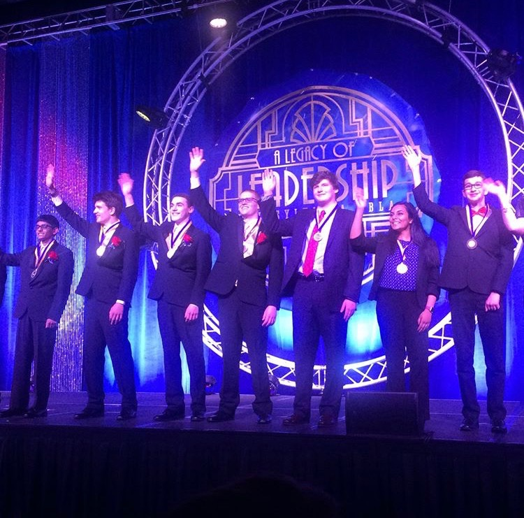 Dubil and his peers being formally inducted into their state officer positions.