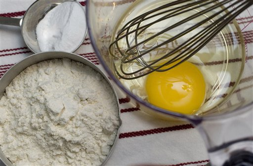Ingredients and tools used in baking are seen in this Oct. 9, 2007 file photo. (AP Photo/Larry Crowe, FILE)