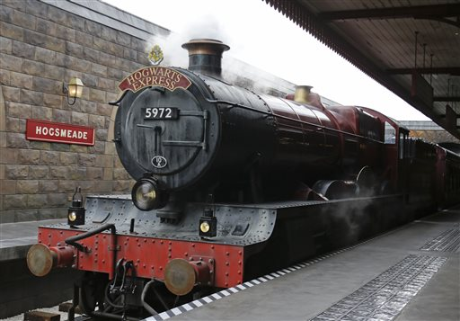 The Hogwarts Express arrives at Hogsmeade station during a preview of Diagon Alley at the Wizarding World of Harry Potter at Universal Orlando, Thursday, June 19, 2014, in Orlando, Fla. (AP Photo/John Raoux)