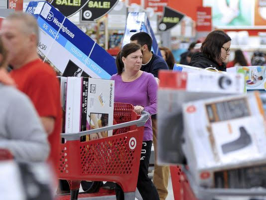 Shoppers maneuver through this Target store in Plainville, Mass., shortly after the store opened at 1 a.m. Friday, Nov. 25, 2016. Large screen televisions were among the popular items purchased. (AP Photo/Mark Stockwell)